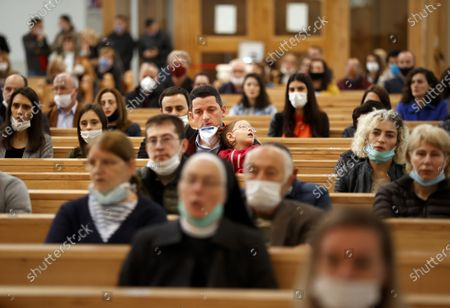 Faithful wearing face masks attend the Sunday Mass at the Mother Teresa cathedral amid the ongoing coronavirus COVID-19 pandemic in Pristina, Kosovo, 31 May 2020. Faithful attended the Sunday mass for the first time since mid-March when the KosovoÕs government closed borders and suspended activities in a bid to control the spread of the COVID-19 disease caused by the SARS-CoV-2 coronavirus in the West Balkan country.