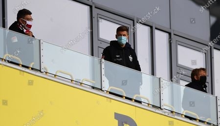 Stuttgart's (L-R) president Claus Vogt, head of sport Thomas Hitzlsperger, and sports director Sven Mislintat wear protective face masks during the German Bundesliga Second Division soccer match between Dynamo Dresden and VfB Stuttgart in Dresden, Germany, 31 May 2020. The team of Dynamo Dresden resumed play after missing the restart of the Second Bundesliga due to two COVID-19 cases resulting in a 14-day quarantine imposed by the public health department amid the ongoing coronavirus COVID-19 pandemic.