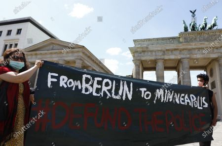 Supporters of the Black Lives Matter movement hold placards and banners to protest against the police brutality in the US following the death of George Floyd, in front of the US Embassy to Germany in Berlin, Germany, 31 May 2020. A bystander's video posted online on 25 May appeared to show George Floyd, 46, pleading with arresting officers that he couldn't breathe as an officer knelt on his neck, in Minnesota, USA. The unarmed black man later died in police custody.