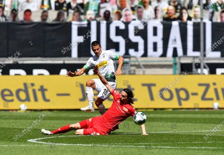 Moenchengladbach's Stefan Lainer (back) in action against Union's Neven Subotic (front) during the German Bundesliga soccer match between Borussia Moenchengladbach and Union Berlin in Moenchengladbach, Germany, 31 May 2020.