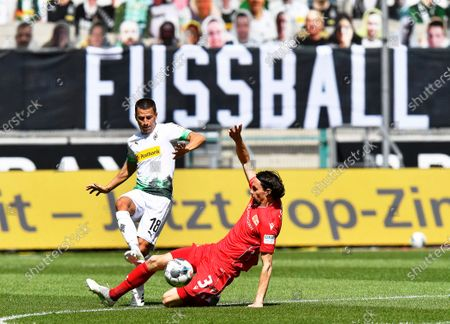 Moenchengladbach's Stefan Lainer (L) in action against Union's Neven Subotic (R) during the German Bundesliga soccer match between Borussia Moenchengladbach and Union Berlin in Moenchengladbach, Germany, 31 May 2020.