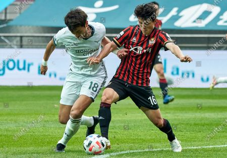 Stock Photo of Yang Dong-hyun of Seongnam FC competes for the ball with Ju Se-jong of FC Seoul during 2020 K League 1 match between Seongnam FC and FC Seoul at the seoul world cup stadium in Seoul, South Korea, on May 31, 2020.