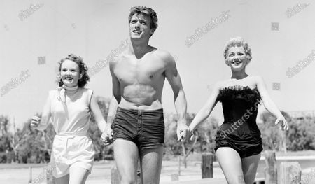 Actresses Olive Sturgess, left, of Ocean Falls, British Columbia, and Dani Crayne of Minneapolis, Minn., flank actor Clint Eastwood. Eastwood turns 90 on Sunday, May 31