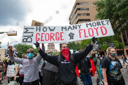 People march at the Texas State Capitol on May 31, 2020 in Austin, Texas to protest the death of George Floyd, an unarmed black man who died after being pinned down by a white police officer in Minneapolis.
