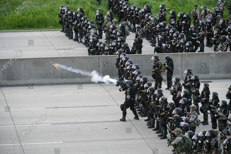 The State Patrol fires teargas at protesters on the I35 during the sixth day of demonstrations over the arrest of George Floyd, who later died in police custody, in St Paul, Minnesota, USA, 31 May 2020. A bystander's video posted online on 25 May, shows George Floyd pleading with arresting officers that he couldn't breathe as an officer knelt on his neck. The unarmed black man soon became unresponsive, and was later pronounced dead. According to reports on 29 May, Derek Chauvin, the police officer at the center of the incident, has been taken into custody and charged with murder in the death of George Floyd.
