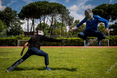 Stock Image of Aldo Montano (R) athlete of national interest, fencer belonging to the Blue Flames Sports Group of the Penitentiary Police, trains with Andra Valentini in the sports center of Casal del Marmo
