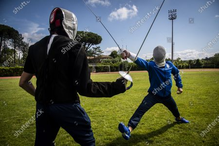 Stock Photo of Aldo Montano (R) athlete of national interest, fencer belonging to the Blue Flames Sports Group of the Penitentiary Police, trains with Andra Valentini in the sports center of Casal del Marmo