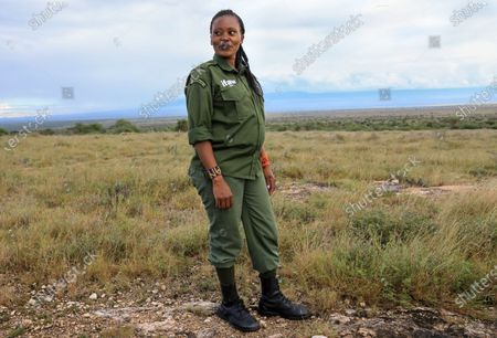 Anastacia Sein, 27, a former kindergarten teacher and 7 months pregnant, is one of the eight members of the first Kenyan female Maasai community ranger's unit known as 'Team Lioness', poses for a photo during an interview at the Olulugului-Olareshi group ranch, an expansive area of traditional Maasai community land in Amboseli, Kajiado, Kenya, on 15 May 2020 (issued 01 June 2020). The female rangers are part of a total of 76 community rangers who are financed by the International Fund for Animal Welfare (IFAW), and patrol a route of at least 20 kilometres every day to look out for any illegal activity or injured animals as a way of preventing poaching and reducing human wildlife conflict. Their patrol area is part of the 607 square kilometres of communal land around Amboseli National Park in visual range of Mount Kilimanjaro in Tanzania, the highest peak in Africa. The park is also a passageway for thousands of elephants in the middle of Maasai land. Due to the COVID-19 coronavirus pandemic, the lioness team members have not been able to go home since early March 2020 and the team has been living in their camps as a preventive measure to stop the spread of the virus and from contracting the virus. The closure of borders and the threat of the coronavirus has emptied the Kenyan parks, the main tourist attraction in the country, affecting also the Maasai communities that are highly depending on their income from the tourism - either in formal jobs, by selling small jewels to tourists or even by a small fee from tourists visiting their 'boma', the circular mud house villages where most of this ethnic group live. The IFAW funded rangers had to increase their patrols to ensure that poachers do not exploit any gaps that may arise leading to an increase in poaching.