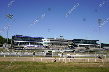 James Sullivan riding Zodiakos (L, orange) win The Betway Welcome Back British Racing Handicap at Newcastle Racecourse on June 01, 2020. (Photo by Alan Crowhurst/Getty Images supplied by Hugh Routledge in The Racing Photographers' Pool