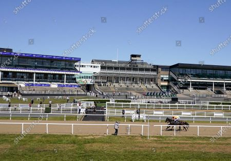 James Sullivan riding Zodiakos (L, orange) win The Betway Welcome Back British Racing Handicap with the backdrop of empty grandstands as racing takes place behind closed doors at Newcastle Racecourse on June 01, 2020. (Photo by Alan Crowhurst/Getty Images supplied by Hugh Routledge in The Racing Photographers' Pool.