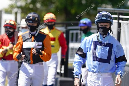 Paul Mulrennan (R) leads the jockeys to the parade ring at Newcastle Racecourse on June 01, 2020. (Photo by Alan Crowhurst/Getty Images, supplied by Hugh Routledge in The Racing Photographers' Pool)