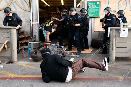 Law enforcement evict people from the Whole Foods in the Fairfax District on Saturday, May 30, 2020 in Los Angeles, CA. Protests erupted across the country, with people outraged over the death of George Floyd, a black man killed after a white Minneapolis police officer pinned him to the ground with his knee. (Kent Nishimura / Los Angeles Times)