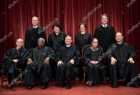 The justices of the U.S. Supreme Court gather for a formal group portrait to include a new Associate Justice, top row, far right, at the Supreme Court Building in Washington. Seated from left: Associate Justice Stephen Breyer, Associate Justice Clarence Thomas, Chief Justice of the United States John G. Roberts, Associate Justice Ruth Bader Ginsburg and Associate Justice Samuel Alito Jr. Standing behind from left: Associate Justice Neil Gorsuch, Associate Justice Sonia Sotomayor, Associate Justice Elena Kagan and Associate Justice Brett M. Kavanaugh