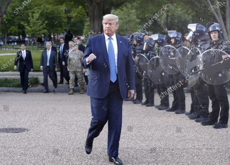 US President Donald J. Trump returns after posing with a bible outside St. John's Episcopal Church after delivering remarks in the Rose Garden at the White House in Washington, DC, USA, 01 June 2020. Trump addressed the nationwide protests following the death of George Floyd in police custody.
