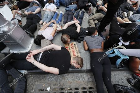 Protesters in Times Square during a demonstration over the arrest in Minnesota of George Floyd, who later died in police custody, in New York , New York, USA, 01 June 2020. A bystander's video posted online on 25 May, appeared to show George Floyd, 46, pleading with arresting officers that he couldn't breathe as an officer knelt on his neck. The unarmed black man later died in police custody.