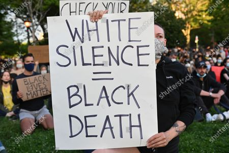 Thousands of protesters hold a thirty minute silent vigil for the Black Lives Matter movement in McCarren Park located in the Greenpoint neighborhood of Brooklyn.