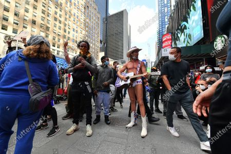 Robert Burck, also known as Naked Cowboy, endorsing Donald Trump, confronts Peaceful Black Lives Matter demonstrators as they protest the death of George Floyd.