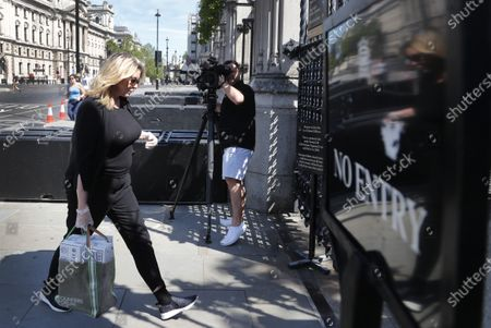 British politician Penny Mordaunt arrives at Parliament in London, . The British government has decided to scrap a remote-voting system used during the coronavirus pandemic, and has summoned lawmakers back to parliament on Tuesday, but many aren't happy with the arrangements
