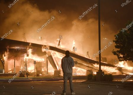 Demonstrators and people rioting created massive fires at the scene of the George Floyd Black Lives Matter protest and riots on May 29, 2020 in Minneapolis, Minnesota