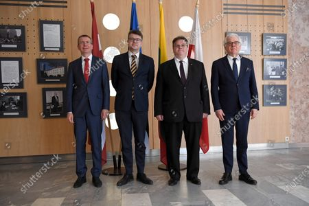 (L-R) The foreign affairs ministers of Latvia, Estonia, Lithuania and Poland - Edgars Rinkevics, Urmas Reinsalu, Linas Linkevicius and Jacek Czaputowicz, respectively - pose for a group photo following a four-way meeting held in Tallinn, Estonia, 02 June 2020. The talks focused on cooperation in the Baltic region amid the ongoing pandemic of the COVID-19 disease caused by the SARS-CoV-2 coronavirus.