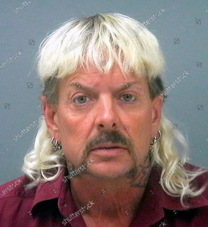 """Provided by the Santa Rose County Jail in Milton, Fla., shows Joseph Maldonado-Passage, also known as Joe Exotic. A federal judge in Oklahoma has awarded ownership of the zoo made famous in Netflix's """"Tiger King"""" docuseries to Joe Exotic's rival, Carole Baskin. In a ruling, U.S. District Judge Scott Palk granted control of the Oklahoma zoo that was previously run by Joseph Maldonado-Passage - also known as Joe Exotic - to Big Cat Rescue Corp"""