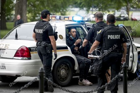 Secret Service police arrest a man for what one eye witness said an officer told him was for having an imitation gun along Constitution Avenue near the White House in the morning as protests continue over the death of George Floyd in Washington, . Floyd died after being restrained by Minneapolis police officers