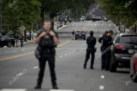 Secret Service police stand guard along 17th Street, which is closed to traffic, near the White House in the morning as protests continue over the death of George Floyd in Washington, . Floyd died after being restrained by Minneapolis police officers