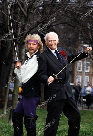 Paul Nicholas and Douglas Fairbanks Jr. fencing with swords 1990