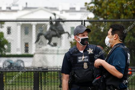 Members of the U.S. Secret Service stand near Lafayette Park across from the White House, in Washington, following protests over the death of George Floyd, who died after being restrained by Minneapolis police officers