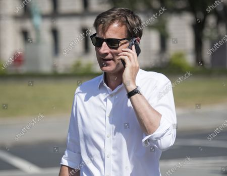 Conservative MP Jeremy Hunt Is seen arriving at The Houses of Parliament in London ahead of a 90-minute debate on the new voting system and a series of votes this afternoon. Government has introduced further measures to slowly ease lockdown, which was introduced to fight the spread of the COVID-19 strain of coronavirus.