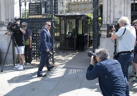 Conservative MP Liam Fox Is seen arriving at The Houses of Parliament in London ahead of a 90-minute debate on the new voting system and a series of votes this afternoon. Government has introduced further measures to slowly ease lockdown, which was introduced to fight the spread of the COVID-19 strain of coronavirus.