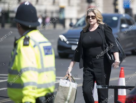 Conservative MP Penny Mordaunt Is seen arriving at The Houses of Parliament in London ahead of a 90-minute debate on the new voting system and a series of votes this afternoon. Government has introduced further measures to slowly ease lockdown, which was introduced to fight the spread of the COVID-19 strain of coronavirus.