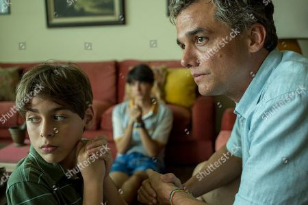 Stock Image of Joao Barreto as Adrien, 13 Years Old, Eduardo Melo as Laurent, 16 Years Old and Wagner Moura as Sergio Vieira de Mello