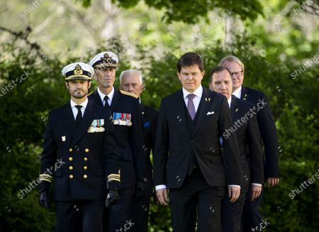 Prince Carl Philip, General Micael Bydén, Sverker Goranson, chairman of the Swedish Veterans Association, Andreas Norlén, Speaker of the Parliament, Prime Minister Stefan Lofven and Peter Hultqvist, Minister for Defence, during Sweden's Veterans Day at the Kungsangen regiment