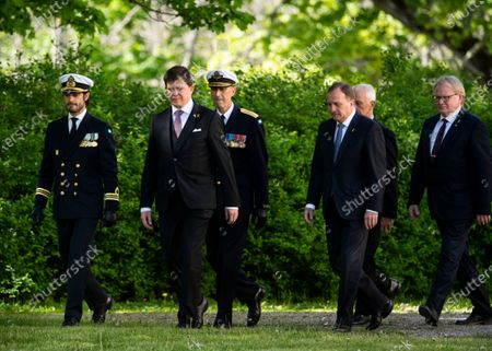 Prince Carl Philip, Andreas Norlén, Speaker of the Parliament, General Micael Bydén, Prime Minister Stefan Lofven, Sverker Goranson, chairman of the Swedish Veterans Association, and Peter Hultqvist, Minister for Defence, during Sweden's Veterans Day at the Kungsangen regiment