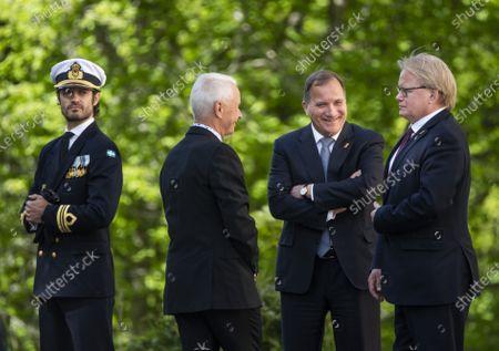 Prince Carl Philip, Sverker Goranson, chairman of the Swedish Veterans Association, Prime Minister Stefan Lofven and Peter Hultqvist, Minister for Defence, during Sweden's Veterans Day at the Kungsangen regiment