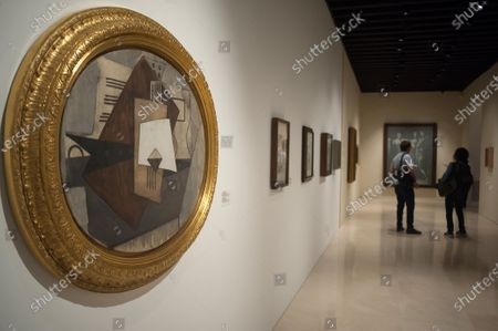 """Stock Image of A painting is seen displayed during the exhibition of """"Dialogues with Picasso: collection 2020-2023"""" at Picasso Museum. The new permanent collection arrives at the museum with 120 works organised by Almine Foundation, Bernard Ruiz-Picasso for the Art (FABA) and supported by the artistic team of the Picasso Museum. This exhibition has artworks as important as a tapestry based on the original paintings of 'The ladies of Avignon', the cubist sculpture 'Glass of absinthe' or the painting 'Susanna and the elders'."""