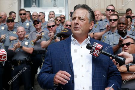 John George, President, Fraternal Order of Police, Oklahoma City, is applauded as he speaks in support of Oklahoma City Police Chief Wade Gourley, in Oklahoma City. The group Black Lives Matter, Oklahoma City, has called for the resignation of Gourley