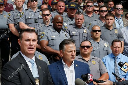 Mark Nelson, left, Vice President, Fraternal Order of Police, Oklahoma City, and John George, right, President, speak in support of Oklahoma City Police Chief Wade Gourley, in Oklahoma City. The group Black Lives Matter, Oklahoma City, has called for the resignation of Gourley