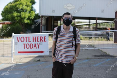 Bernie Sanders supporter Sergio Marquez poses for a photo outside of a polling station during primary voting, in Santa Fe, New Mexico. Marquez wanted to vote for Sanders even though he's out of the race and Joe Biden is the presumptive Democratic presidential nominee. But Marquez says he wasn't able to vote because he had not registered as a Democrat; New Mexico's primaries are closed to party members