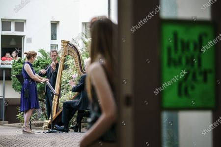 Violinist Andreas Jentzsch (4-L) and harpist Stephen Fitzpatrick (5-L) perform during a test run for the Hofkonzerte concerts in Berlin, Germany, 02 June 2020. 