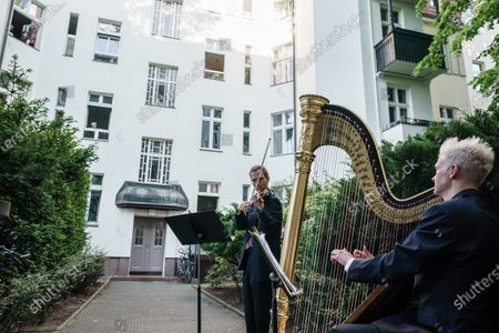 Violinist Andreas Jentzsch (L) and harpist Stephen Fitzpatrick (R) perform during a test run for the Hofkonzerte concerts in Berlin, Germany, 02 June 2020. 