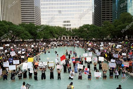 People rally to protest the death of George Floyd in Houston on . Floyd died after a Minneapolis police officer pressed his knee into Floyd's neck for several minutes even after he stopped moving and pleading for air