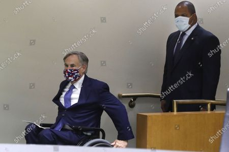Amid concerns of the spread of COVID-19, Texas Gov. Greg Abbott, left, and Dallas Mayor Eric Johnson wear masks as they arrive to speak at a news conference at city hall in Dallas, . Abbott and local officials were on hand to discuss the response to protests in Texas over the death of George Floyd