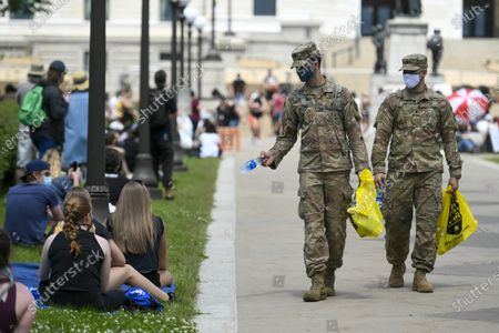 National Guardsmen pass out water as thousands of protesters turn out for a sit in at the State capitol, more than a week after George Floyd's death while under arrest, in St Paul, Minnesota, USA, 02 June 2020. A bystander's video posted online on 25 May, shows George Floyd, 46, pleading with arresting officers that he couldn't breathe as one officer knelt on his neck. The unarmed black man soon became unresponsive, and was later pronounced dead. According to news reports on 29 May, Derek Chauvin, the police officer in the center of the incident has been taken into custody and charged with murder in the George Floyd killing.