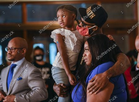 Stephen Jackson (C) holds George Floyd's daughter Gianna Floyd (2-L), 6, and stands next to Gianna's mother Roxi Washington as they appear at a news conference about Floyd's death while under arrest, in Minneapolis, Minnesota, USA, 02 June 2020. A bystander's video posted online on 25 May, shows George Floyd, 46, pleading with arresting officers that he couldn't breathe as one officer knelt on his neck. The unarmed black man soon became unresponsive, and was later pronounced dead. According to news reports on 29 May, Derek Chauvin, the police officer in the center of the incident has been taken into custody and charged with murder in the George Floyd killing.