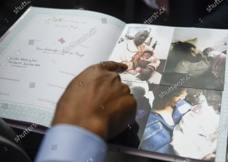 Attorney Chris Stewart held Gianna Floyd's baby book featuring a photo of George Floyd holding his daughter after a news conference about Floyd's death while under arrest, in Minneapolis, Minnesota, USA, 02 June 2020. A bystander's video posted online on 25 May, shows George Floyd, 46, pleading with arresting officers that he couldn't breathe as one officer knelt on his neck. The unarmed black man soon became unresponsive, and was later pronounced dead. According to news reports on 29 May, Derek Chauvin, the police officer in the center of the incident has been taken into custody and charged with murder in the George Floyd killing.
