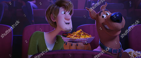 Stock Photo of Shaggy Rogers (Will Forte) and Scooby-Doo (Frank Welker)
