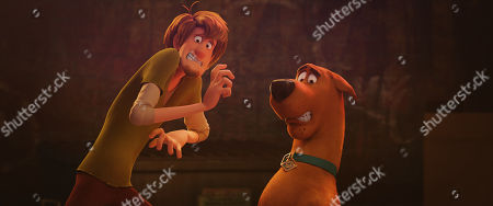 Stock Picture of Shaggy Rogers (Will Forte) and Scooby-Doo (Frank Welker)