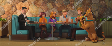 Stock Photo of Himself (Simon Cowell), Velma Dinkley (Gina Rodriguez), Daphne Blake (Amanda Seyfried), Fred Jones (Zac Efron), Shaggy Rogers (Will Forte) and Scooby-Doo (Frank Welker)